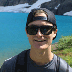 Ski business & Resort Management student connor clayton relaxes lake side