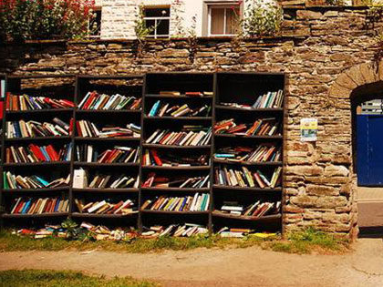 Filled bookshelf in Hay-on-Wye, Wales famous as the Town of Books