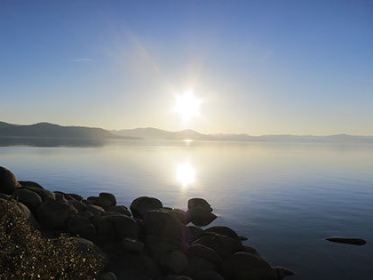 The sun reflected in Lake Tahoe during a summer sunset