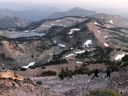 Lassen NP - students navigate the switchbacks on a sunrise hike up Mt. Lassen