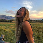 sustainability and Ski business Resort Management alumna marina mccoy enjoys a sunset