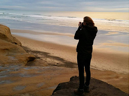 journalism and digital arts student morgan meadows photographing sunset on the beach