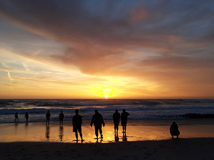 A spectacular sunset on the beach in Monterey during a Sierra Nevada College science trip.