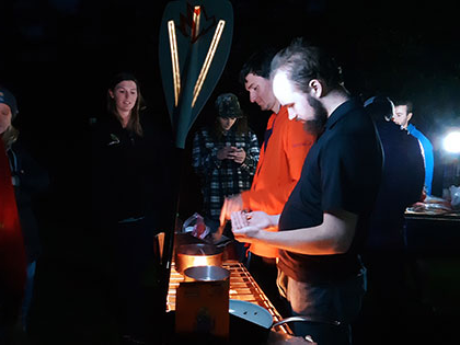 Sierra Nevada College science students cook a late dinner at the Veteran's Memorial Park campground in Monterey at the Monterey Aquarium during the science department spring trip