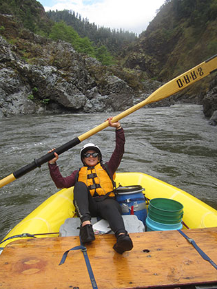 Kim Oyervides, Environmental Science major, sits in raft while oaring
