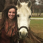 outdoor adventure leadership and psychology major sydney pinkerton enjoys spending time with her horse