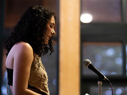 Sierra Nevada College art and creative writing student Nikki Sardelli performing at the 2019 Tahoe Slam, held at Sierra Nevada College during National Poetry Month
