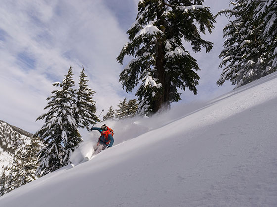 Skiier in powder on Incline Peak. Photo by SNC Tahoe digital arts and outdoor adventure leadership major garrett ramos.