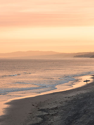 Surfer on the beach at San Elijo, sunrise. Photo by digital arts and outdoor adventure leadership major garrett ramos
