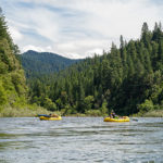 oar boats enjoy a quiet spot on the river - Sierra Nevada University environmental science and outdoor adventure leadership students in field courses on the Wild and Scenic Rogue River