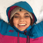 nicole ross takes break from reading to lay in the snow at SNC Tahoe