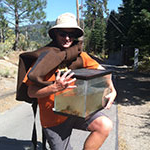 Gus Tjenagel, Science major, holding tank with non-native fish to put in Truckee River