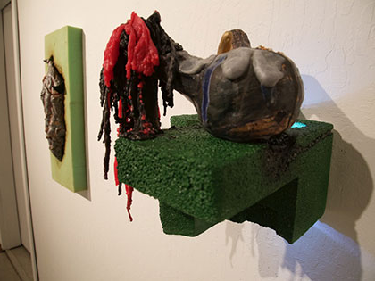 Ian Wieczorek, Bachelor of Fine Arts, displays ceramic piece hanging on wall at SNC Tahoe