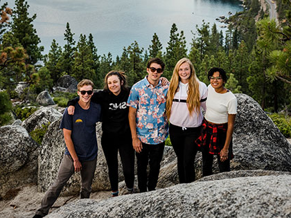 Sierra Nevada University students on a mountain high above Lake Tahoe