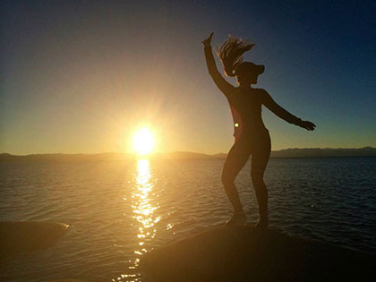 全球商业管理 major Kristine Adde dances at sunset shoreside at Lake Tahoe