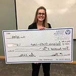 Giulianna Crivello, Entrepreneurship major, holding check she won at the Business Plan Competition