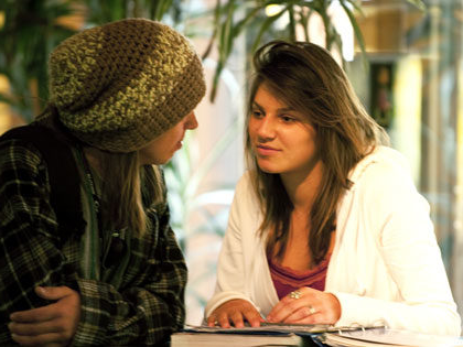 two female students deep in conversation