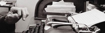 Writer working on old typewriter