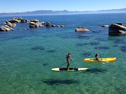 SNU Tahoe students go paddle boarding and kayaking on Lake Tahoe