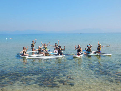 SNU Tahoe students go paddle-boarding during the Tahoe Orientation, a way for new students to get to know each other better