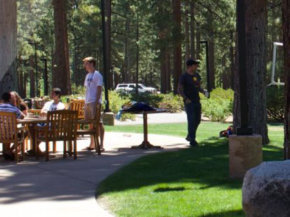 students relax between classes outside Patterson Dining Hall at Sierra Nevada University