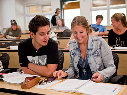 Collaborating students work on assignments at SNU Tahoe
